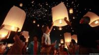 Mourners launch thousands of floating paper lanterns into the sky over the Andaman Sea in remembrance of the 2004 Indian Ocean tsunami victims, in Khao Lak, in Thailand