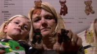 Rebecca Stoddard with her children shopping online