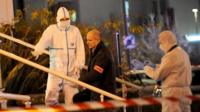 Forensic police collect evidence outside the police station of Joue les-Tours