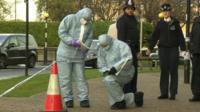 Forensics examining a crime scene