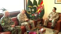 Pakistani army chief Raheel Sharif (R) meeting with General Sher Muhammad Karimi (L) Chief of General Staff Afghan National Army (ANA), and General John Campbell (C), Commander ISAF