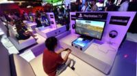 A gamer playing PlayStation