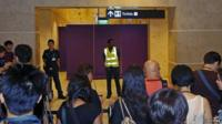 Journalists crowd the waiting area for relatives of passengers