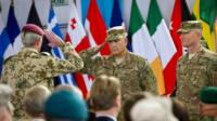 Commander ISAF, General John F. Campbell (centre) salutes Commander Joint Force Command Brunssum, General Hans-Lothar Domrose during the Change of Mission Ceremony in Kabul