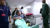 Patient Ricky Groom being wheeled into A&E at Wolverhampton Hospital