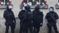 Police in Longpont during manhunt for shooting suspects
