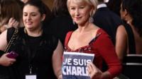 "Dame Helen Mirren holding banner reading ""Je suis Charlie"""