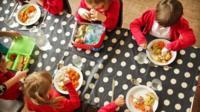 Pupils eating healthy roast dinner