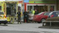 Victim taken to ambulance at Mold Tesco store