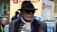 Gary Glitter is standing trial under his real name, Paul Gadd