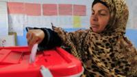 Tunisian woman casting vote