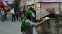 A protestor in gas mask