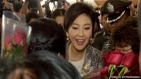 Yingluck Shinawatra greeted by supporters as she arrives for impeachment hearing