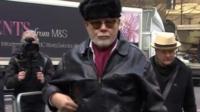 Paul Gadd aka Gary Glitter arrives at court (black hat)