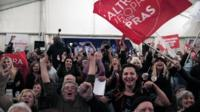 Syriza supporters celebrate as the results come in
