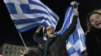 Anti austerity Syriza party supporters celebrate