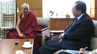 The Dalai Lama (l) with