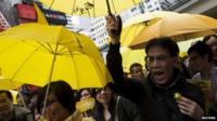 Protesters with yellow umbrellas