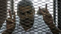 Mohamed Fahmy behind wire