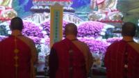 Monks mourn plane crash victims