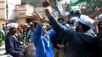 Indian Aam Aadmi Party (AAP) supporters celebrate the AAP's victory in the state assembly elections