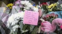 Floral tributes at the crash site on Lansdown Lane, Bath where an out-of-control tipper truck killed four people