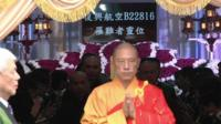 Monk leaving mass for TransAsia victims