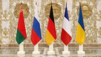 Flags of nations attending peace talks