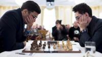 (L) Indian chess grandmaster Viswanathan Anand and (R) US/Italian grandmaster Fabiano Caruana during round three of the Zurich Chess Challenge 2015