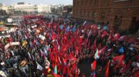 Activists from Russia's Anti-Maidan movement gather together waving various patriotic flags in central Moscow