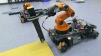 A robot holding a table leg