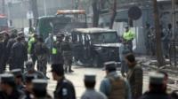 Police at the scene of the blast in Kabul
