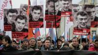 People march in memory of Russian opposition leader and former Deputy Prime Minister Boris Nemtsov in central Moscow