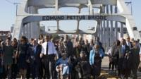 President Obama and others cross the Edmund Pettus Bridge