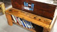 a bench with built-in library