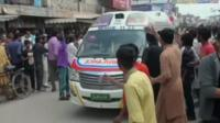 An Ambulance leaves the scene in Lahore
