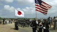 American and Japanese flags held aloft at ceremony to mark 70th anniversary of the battle of Iwo Jima