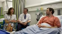 David Cameron and his wife Samantha talk to patient Tom Lawrence during a visit to Salford Royal Hospital - 28 March 2015