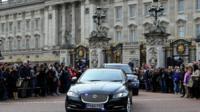 David Cameron's motorcade leaving Buckingham Palace