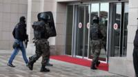 Members of special security forces enter the main courthouse in Istanbul