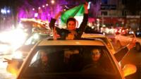 Iranians celebrate on a street in northern Tehran, Iran, after Iran's nuclear agreement with world powers