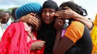 Some of the Garissa University students who were rescued, comfort each other at the Garissa military camp, in Garissa town