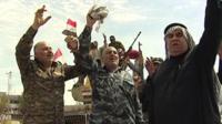 Iraqi forces celebrate in Tikrit