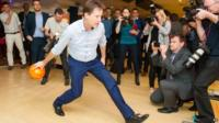 Nick Clegg takes part in ten-pin bowling during a General Election campaign visit to Colchester, Essex