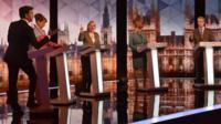 The five leaders standing at their podiums