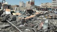 Damaged buildings and debris in Aden, Yemen following Saudi air strikes