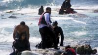 Greek coastguard and locals help to rescue migrants