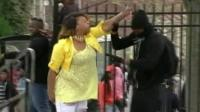 Woman hitting man dressed in black