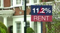 House with BBC graphic saying 11.2% increase in rent on house board