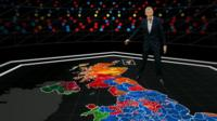 Jeremy Vine standing on coloured-in graphic of map of Britain